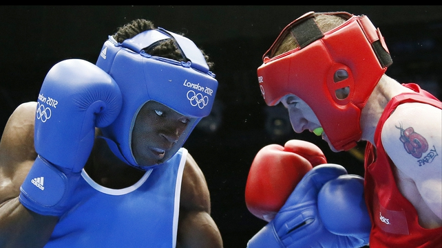 Thomas Essomba (l) in action against Paddy Barnes of Ireland