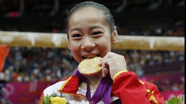It's real! Deng Linlin celebrates after winning gold