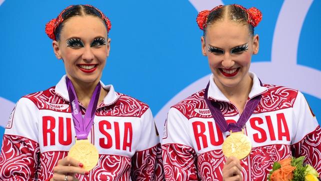 Natalia Ishchenko and Svetlana Romashina celebrate gold