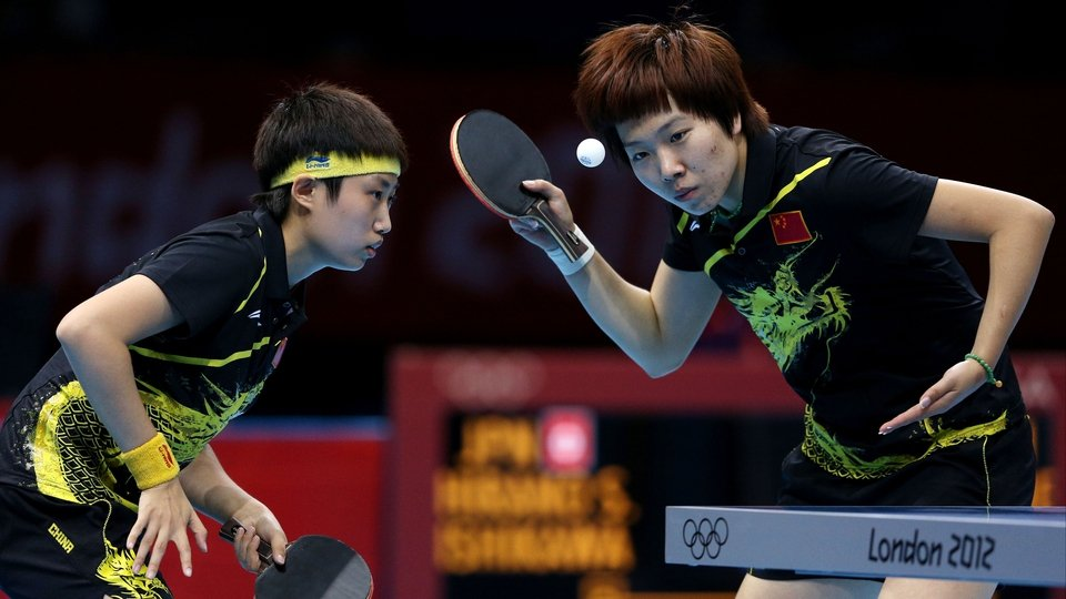 Yue Guo and Xiaoxia Li of China are fully focused on their way to table tennis gold