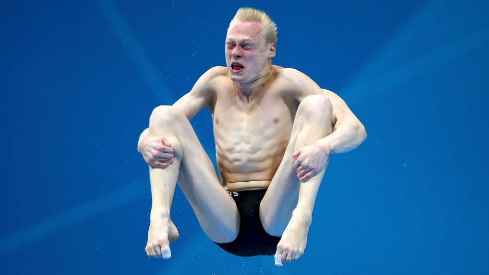 It's more fun than it looks. Russia's Ilya Zakharov grimaces on his way to gold.