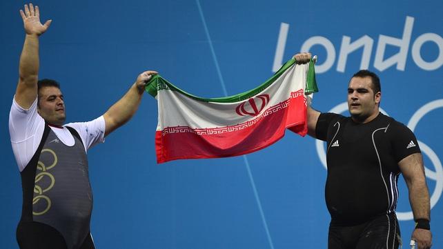 Behdad Salimikordasiabi (R) of Iran celebrates winning the gold medal with compatriot Sajjad Anoushiravani Hamlabad