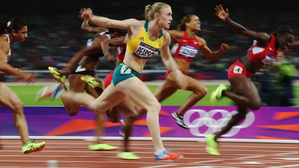 World champion Sally Pearson wins the women's 100 metres hurdles by centimetres
