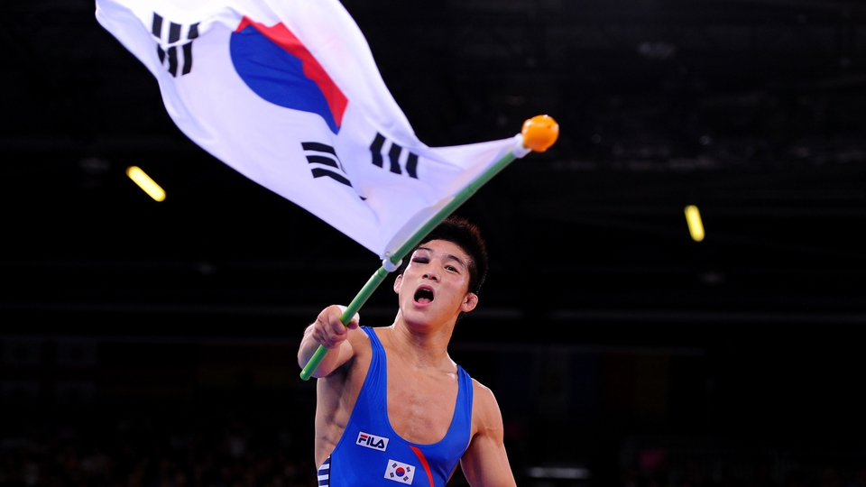 Kim Hyeon-Woo wins wrestling gold, despite being hampered by a serious black eye.