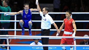Shades of Michael Carruth as Michael Conlan celebrates a win that will guarantee him an Olympic medal