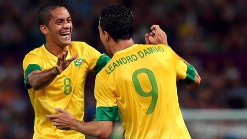 Leandro Damiao of Brazil (9) celebrates with Romulo