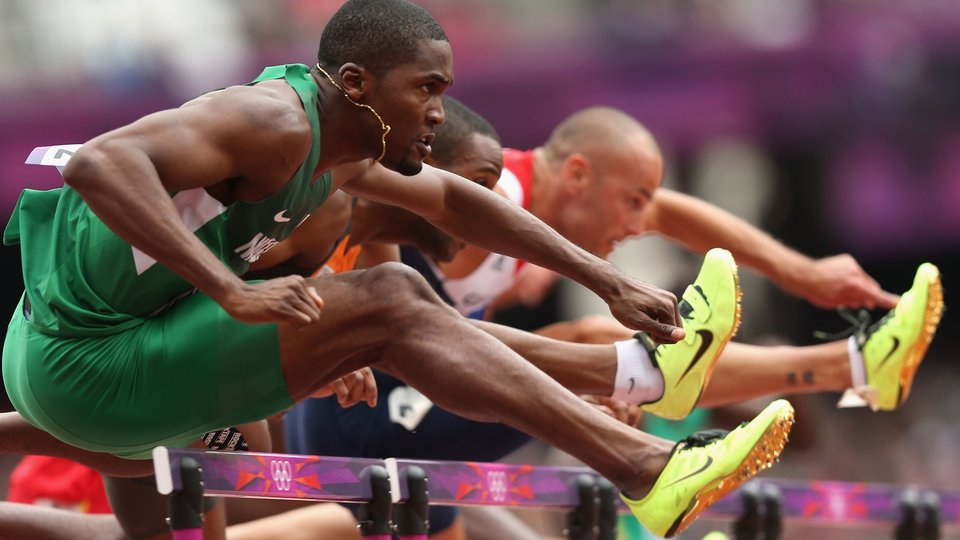 Selim Nurudeen of Nigeria, Gregory Sedoc of Netherlands and Andrew Turner of Great Britain compete in the Men's 110m Hurdles Round 1 Heats