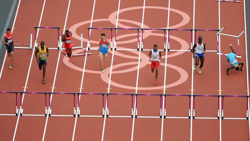 Orlando Ortega of Cuba leads the pack as Shamar Sands of the Bahamas falls over a hurdle in the Men's 110m Hurdles Round 1 Heats