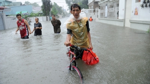 A resident pushes his bicycle through murky floodwaters in Quezon City in suburban Manila