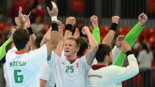 Hungary's pivot Szabolcs Zubai (centre) celebrates with team-mates