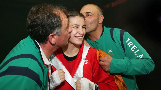 Katie with Zaur Antia (L) and her former trainer, her dad Peter