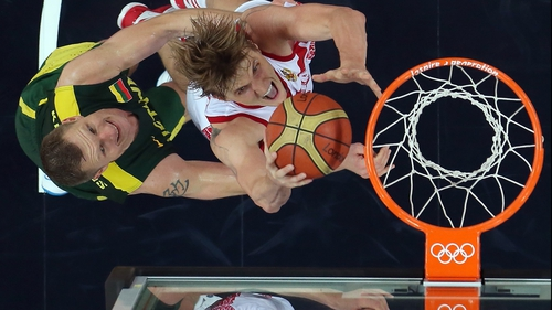 Andrey Kirilenko of Russia goes up for a shot against Rimantas Kaukenas of Lithuania