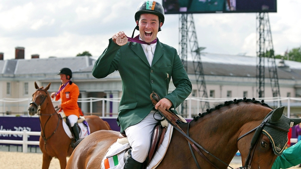 Cian O'Connor celebrates his London success aboard Blue Loyd