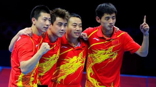 Ma Long, Wang Hao, coach Liu Guoliang and Zhang Jike of China celebrate defeating Korea to win the men's team table tennis gold medal match