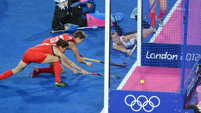 Carla Rebecchi of Argentina (R) dives to score a goal against Britain
