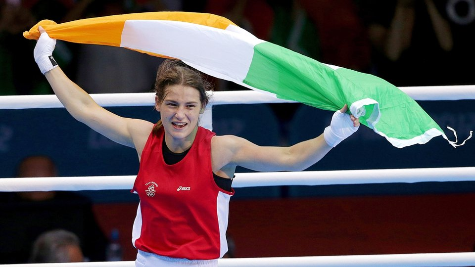 Circling the ring with her national colours flying above her