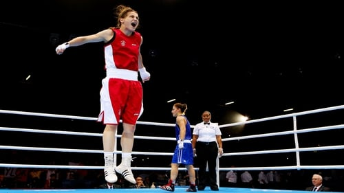 Katie Taylor jumps for joy after winning Olympic gold