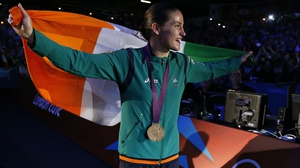 The roof of the Excel Arena was lifted as Katie emerged for the medal ceremony