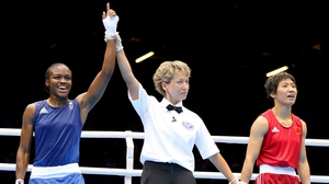 Nicola Adams claimed a convincing win over Ren Cancan
