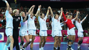 Defending Olympic champions Norway celebrate after beating South Korea in today's semi-final