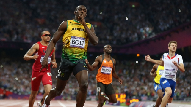 Usain Bolt crosses the line to take the 200m gold