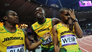Gold, bronze and silver medallists Usain Bolt, Yohan Blake and Warren Weir celebrate after the 200m final
