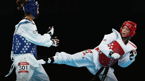 Jade Jones (R) lands a kick on Yuzhuo Hou