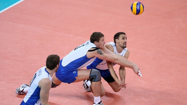Alexander Sokolov (right) and Nikolay Apalikov (centre) of Russia dive for the ball against Bulgaria