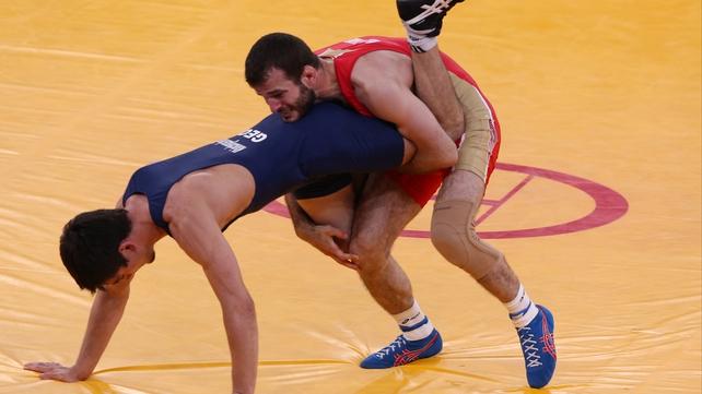Dzhamal Otarsultanov of Russia (red) and Vladimer Khinchegashvili of Georgia