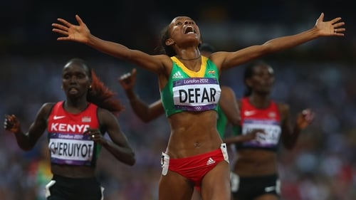 Meseret Defar celebrates as she crosses the line