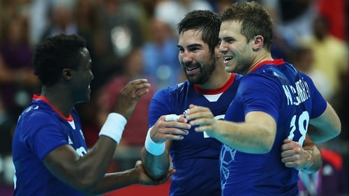 France celebrate their passage to the handball final