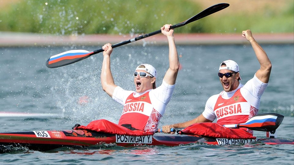 Russian pair Yury Postrigay and Alexander Dyachenko celebrate on the water