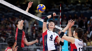 Saori Kimura of Japan (left) scores a point against Sa-Nee Kim of Korea