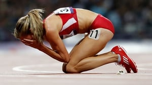 Morgan Uceny is distraught after falling in the 1500m