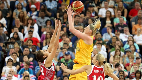 Lauren Jackson of Australia attempts a shot in the second half against Anna Petrakova (l) and Ilona Korstin (r) of Russia