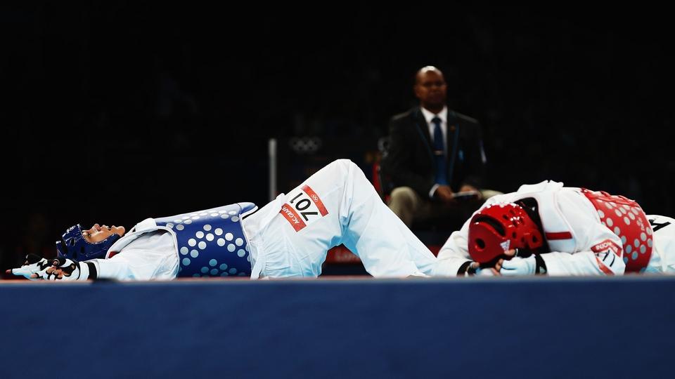 Anne-Caroline Graffe of France celebrates beating In Jong Lee of Korea during the Women's +67kg Taekwondo quarter-final