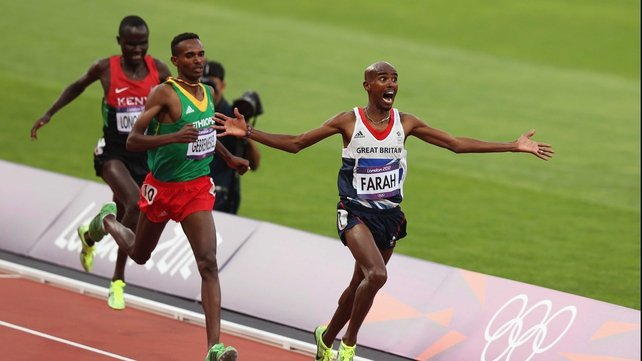 Mohamed Farah of Great Britain crosses the finish line to win gold