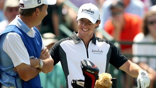 Rory McIlroy hit five birdies in the opening eight holes on Saturday to take a share of the lead
