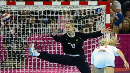 Norway's Linn Jorum Sulland shoots against Montenegro's goalkeeper Sonja Barjaktarovic