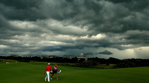 Play was suspended at 4:50pm local time due to electrical storms in South Carolina