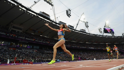 Mariya Savinova of Russia celebrates as she crosses the finish line