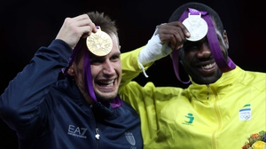 Carlo Molfetta of Italy shows off his gold medal, while Anthony Obame shows off Gabon's first ever Olympic medal