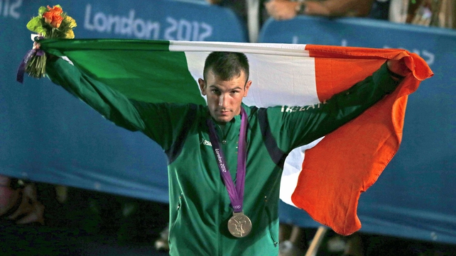 John Joe Nevin flies the flag and wears the medal
