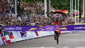 Stephen Kiprotich crosses the winning line