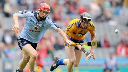 Dublin's Conor McHugh and Jamie Shanahan of Clare chase the sliotar in their minor hurling semi-final at Croke Park