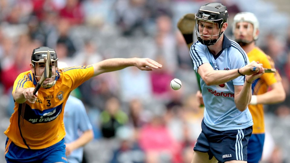 Dublin's Caolan Conway scores his sides second goal despite the best efforts of Clare's Brian Carey