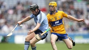 Dublin's Sean McClelland shields possession from Shane Taylor of Clare