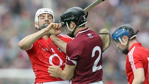 Cork's Pa Cronin is challenged by David Collins of Galway