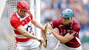 Cork goalkeeper Anthony Nash is closed down by Conor Cooney