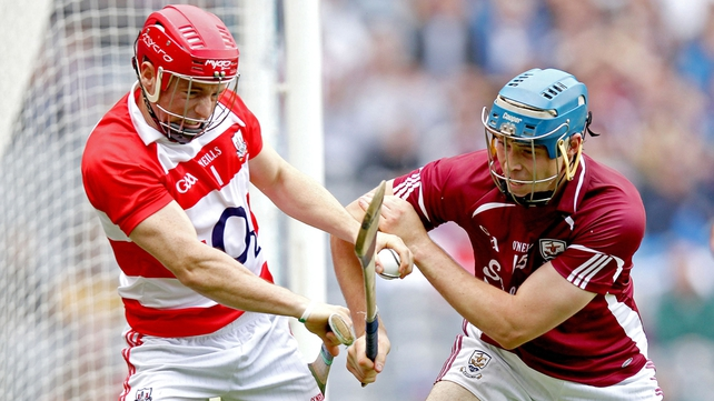 Cork goalkeeper Anthony Nash is challenged by Galway's Conor Cooney
